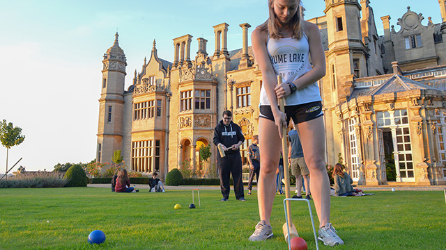 Students playing croquet